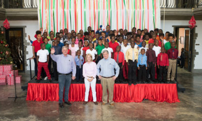 Franklin Graham, Greta Van Susteren, and John Coale celebrate an early Christmas at Greta Home and Academy in Haiti.