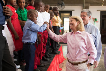 Greta Van Susteren and John Coale connect with residents at the Greta Home and Academy.