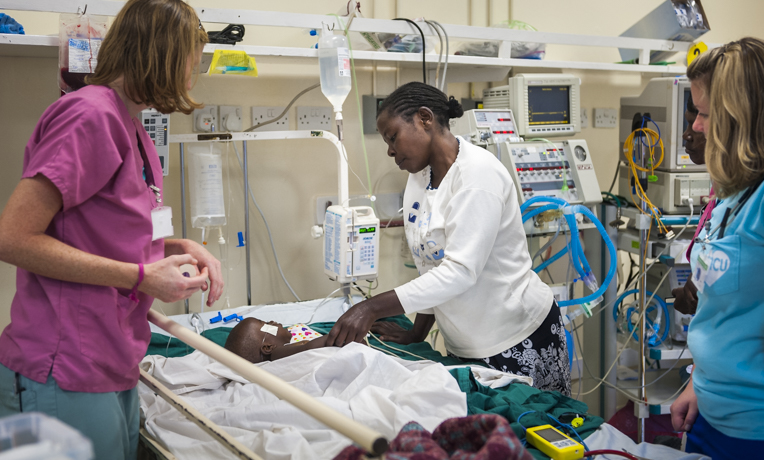 Tenwek Hospital in Kenya serves patients in Jesus' Name. Christian mission hospital staff attend to a patient