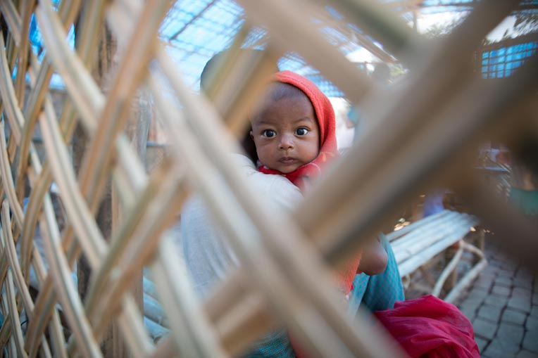Baby looks at the camera at our diphtheria treatment center in Bangladesh.