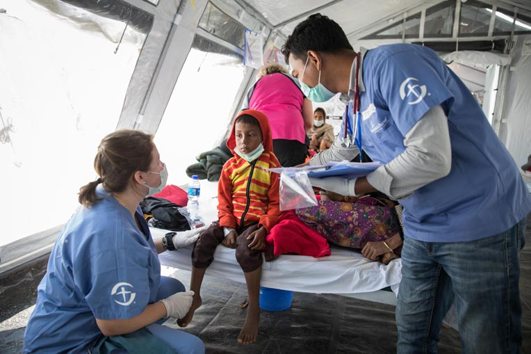 Samaritan's Purse medical staff care for a young Rohingya boy at our treatment center.