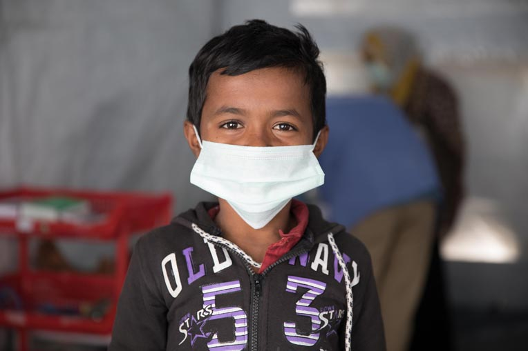 Rohingya boy with mask at our center in Bangladesh.
