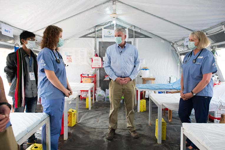 Franklin Graham visits with staff at the Diphtheria Treatment Center.