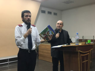 Temo teaches from the Samaritan's Purse Ministry Partner Guide in his current role as discipleship coordinator on Georgia's Operation Christmas Child National Leadership Team.