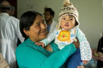 Jhoel's mother Zulema comforts her son after the surgery to repair his cleft lip.