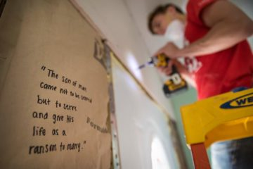 Behind the walls and beneath the floors of our rebuilt homes, our volunteer teams write favorite passages from God's Word.