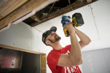 Liberty University student Austin Butler learned how to replace drywall and ceilings for the first time.