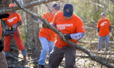 Volunteers are sawing trees and clearing debris during our Southside, Alabama, tornado response.