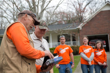 Our volunteers present homeowner Gene Lockette with a Bible signed by the volunteers who worked on his home.