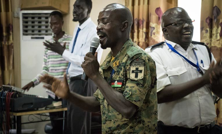 """An army chaplain of the Republic of South Sudan leads his colleagues in song during the opening of the """"Leading Using Biblical Principles"""" workshop in Juba."""