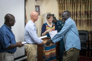 South Sudan Country Director Mark Bennett and Theresa Decker, technical content coordinator, present certificates and study Bibles to participants at the conclusion of the workshop in Juba.