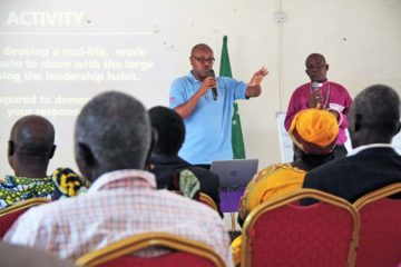 Alex Njukia, ministry program manager, gives instructions for a small group activity during the workshop in Mundri.