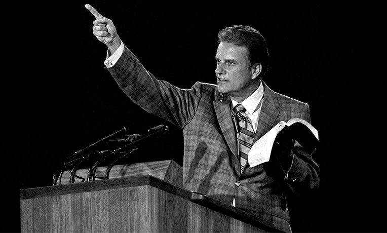 "Billy Graham preaches (historical image)--""Billy Graham: An Extraordinary Journey"""