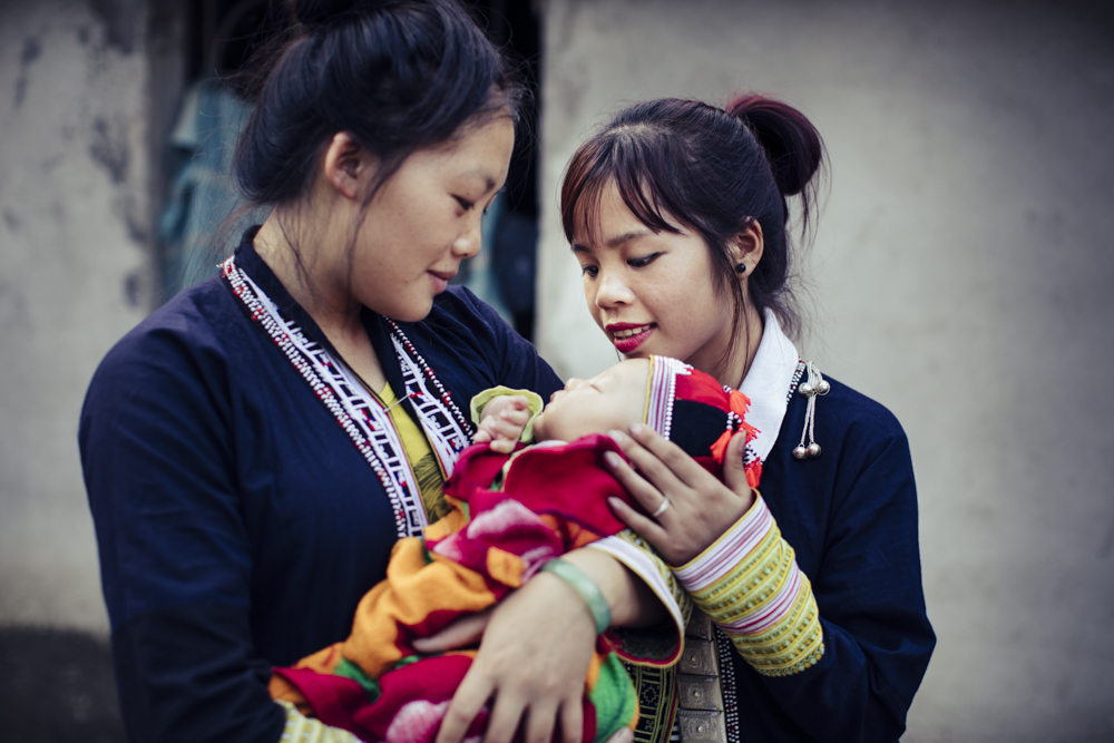 Mother, baby, and traditional birth attendant in Vietnam