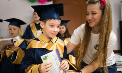 Shoebox recipient Oksana Faik congratulates one of her students who just graduated from The Greatest Journey.