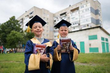 Twins Vladik (left) and Vitaly received Bibles at graduation to help them grow in the Lord and continue sharing Him with others.