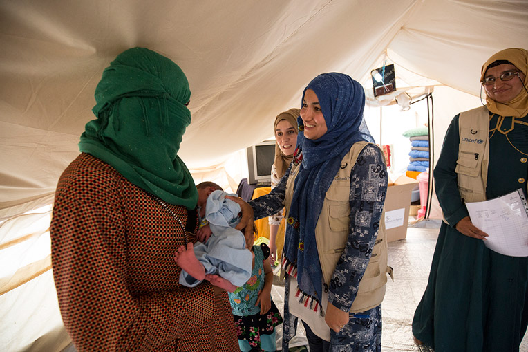 Health workers ISIS refugee baby Iraq