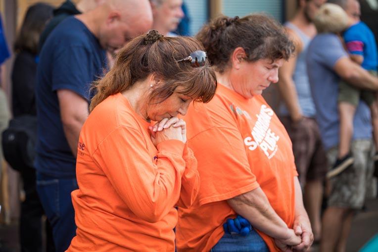 US Disaster Relief volunteers prayer Kauai.