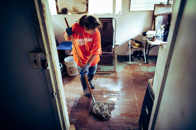 Volunteers are cleaning out mud and debris from homes on Kauai, Hawaii.