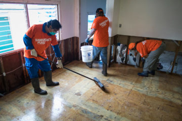 Volunteers are busy clearing debris and treating homes for mold in Kauai.