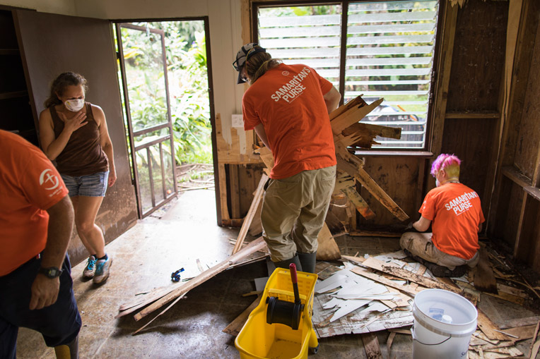 Samaritan's Purse volunteer remove flooring Kauai