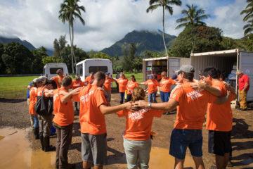 Volunteers praying in Hawaii