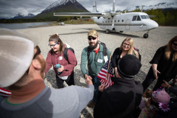 Military couples are warmly greeted at Samaritan Lodge Alaska on May 27 after being flown in from Anchorage aboard our aircraft. Tanalian Mountain provides a spectacular backdrop for the scene.