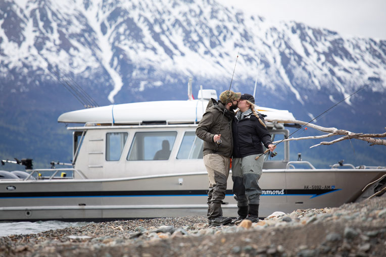 Operation Heal Our Patriots military couple kiss boat mountain lake shore waders fishing