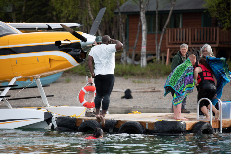 Nick Nelms salutes as he enters the chilly Lake Clark water during the polar plunge at Samaritan Lodge.