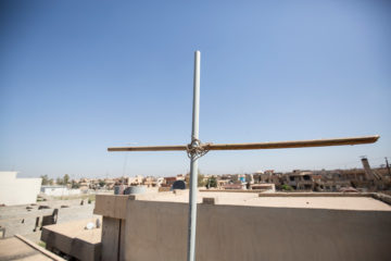 Nabil and his family erected a cross on top of their home to display their devotion to Jesus Christ
