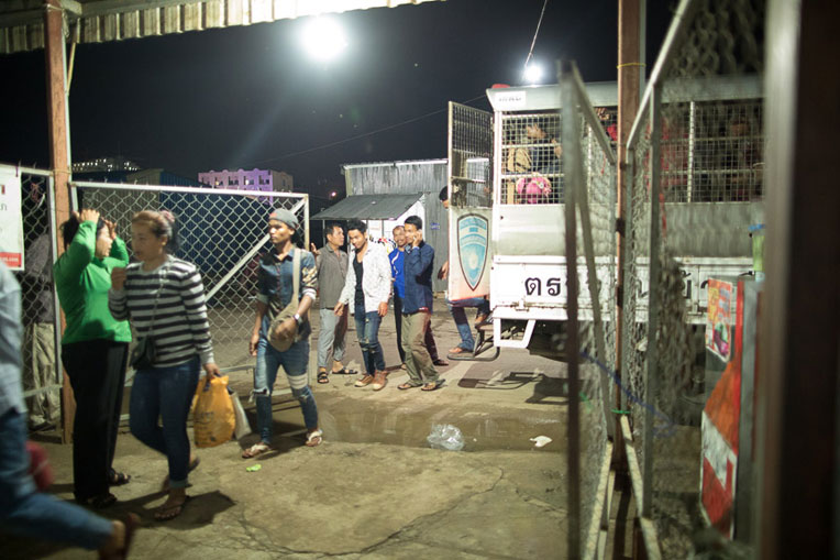 Deported migrant workers arrive at the migrant access center on the Cambodia-Thailand border.