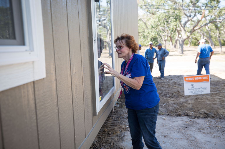 LaVerne Trapp looks inside her new mobile home as we prepare it for her move in.
