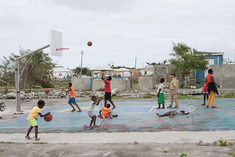 Children on Barbuda playing basketball.