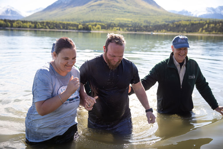 military couple baptized in Lake Clark