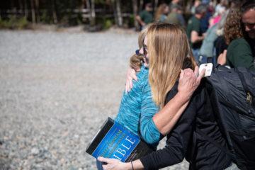 Army Specialist Shawna Watkins hugs a member of our staff as she prepares to depart Samaritan Lodge.