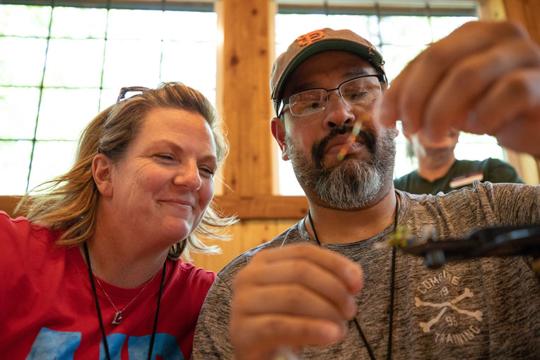 Army Sergeant First Class Albert Gonzalez and Army Specialist Shelly Gonzalez participate in the fly tying competition.