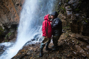 Army Specialist Jacob Ellison and his wife Whitney share a moment near a pristine waterfall in Lake Clark National Park.