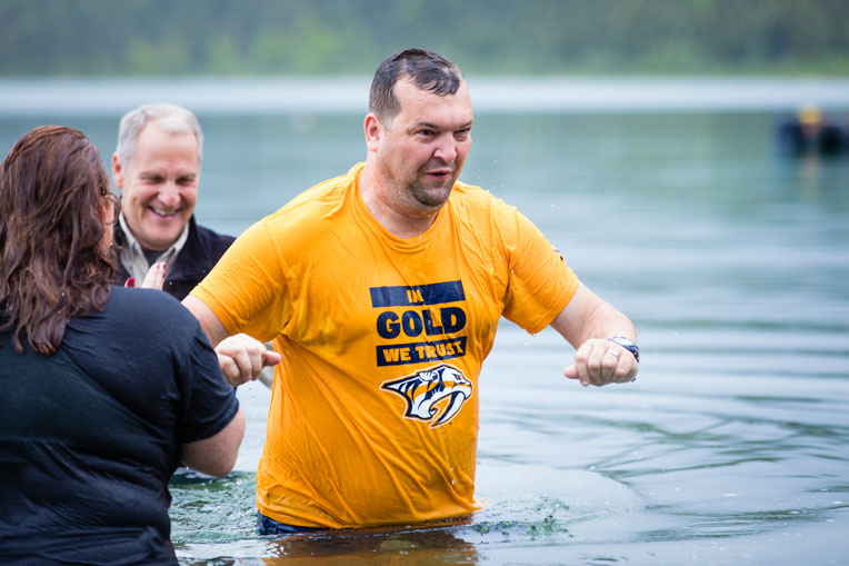 Army Sergeant Stuart Butler and his wife Army Specialist Gennie Butler were baptized in Lake Clark.