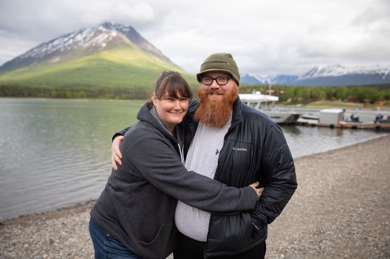 "Army Specialist Luke and Emily Godson hug with Tanalian Mountain in the background. Luke said of the week: ""It changed the way I see my wife and marriage and her personality. And gave me a better conceptualization of what I need to be as a husband and spiritual leader of the home."""