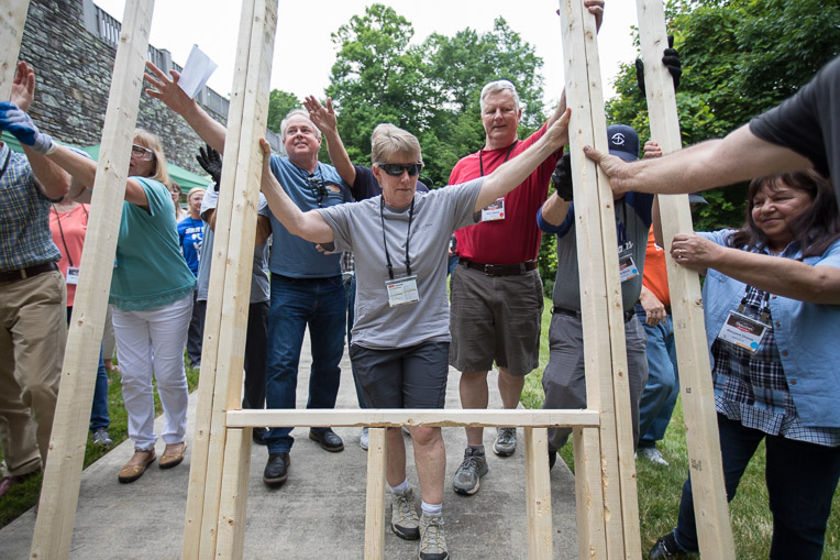 Samaritan's Purse volunteers practicing construction skills.