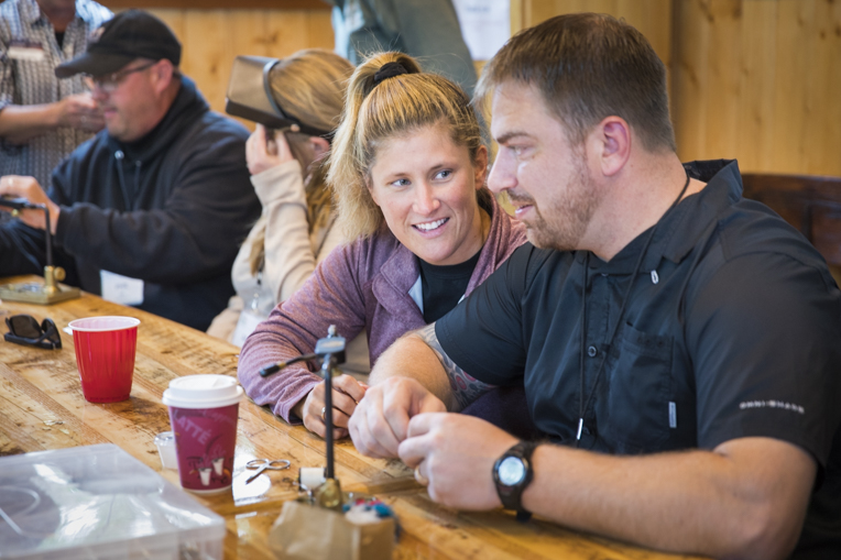 Courtney and her husband, Army Master Sergeant James Keith, work together during a fly fishing tying competition against other military couples.