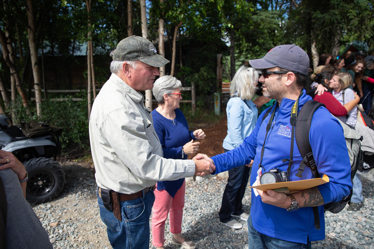 Franklin Graham greets Marine Staff Sergeant Chris Sharon as he prepares to leave Samaritan Lodge Alaska.