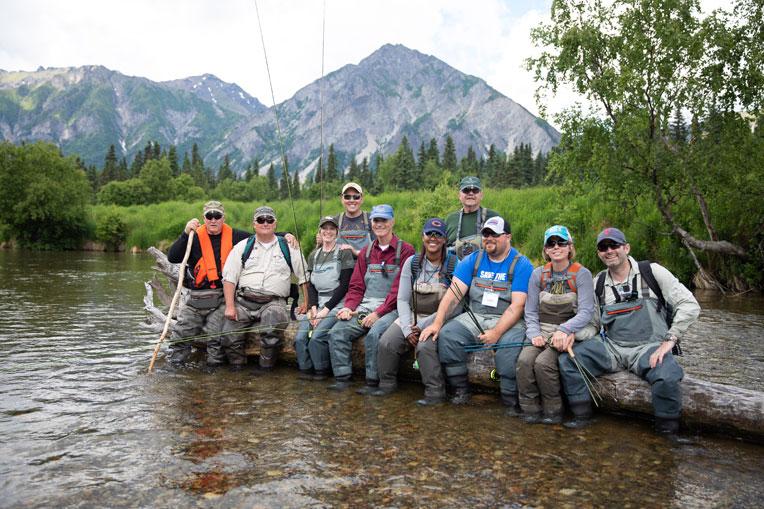 Military couples enjoy a day fishing on Kijik River.