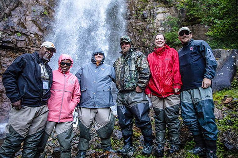 Couples enjoy an afternoon together exploring a waterfall near Samaritan Lodge. Alaska provides couples opportunities to form strong friendships.