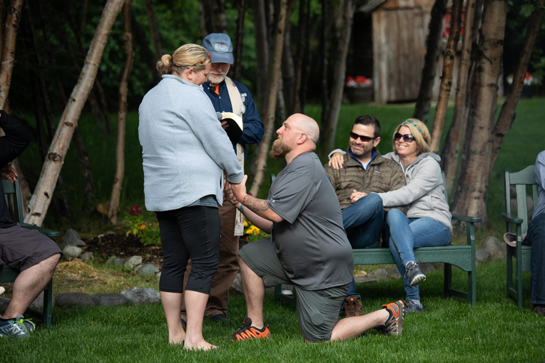 Army Sergeant David Compton kneels as he says his vows during a marriage rededication with his wife Jamie.