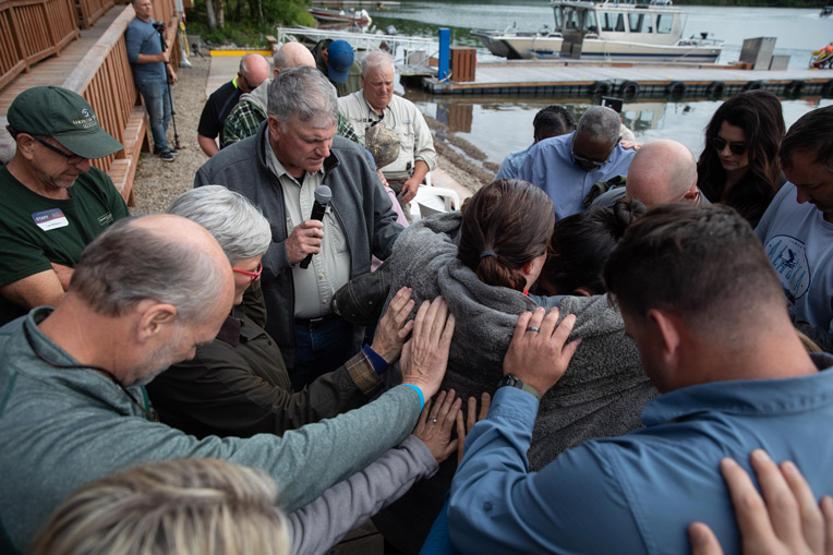 Franklin and Jane Graham pray with participants who were baptized in Lake Clark during Week Six.