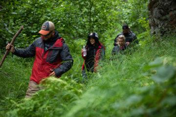 Army Sergeant Marco Solt leads the way up the trail at Kijik Lake near Samaritan Lodge Alaska in Lake Clark National Park.