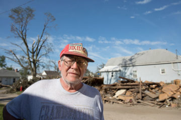 The pile behind Marshalltown 73-year-old homeowner Dean Calkins is what's left of a garage he built by hand several decades ago. By God's grace, Calkins is still alive and he has found new life in Christ this week!