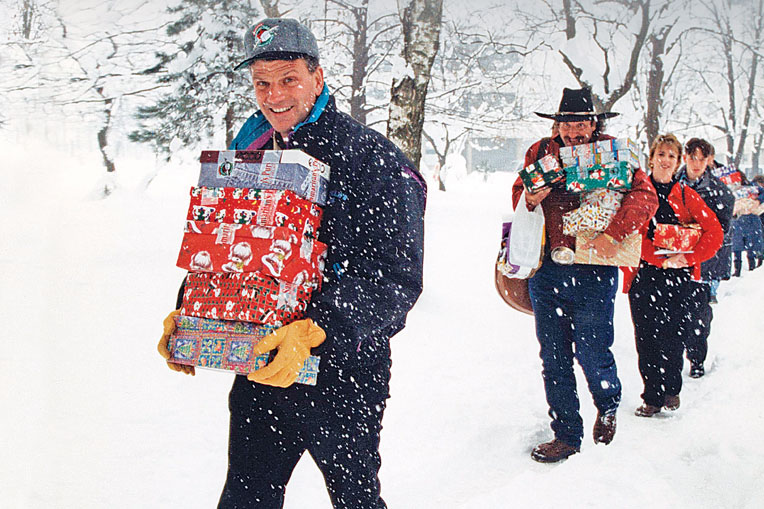 In 1995, Franklin Graham, Dennis Agajanian, and others delivered shoebox gifts in Bosnia.