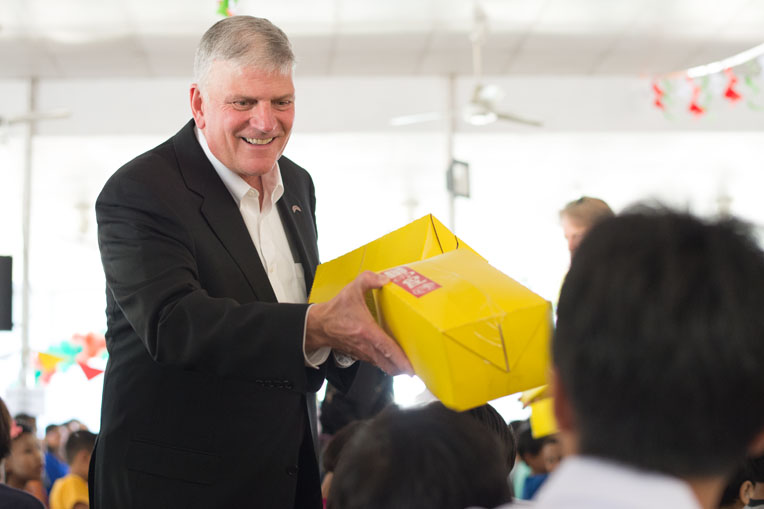 In 2016, Franklin Graham distributed some of the 16,000 shoebox gifts given to the children of Myanmar—a new receiving country for Operation Christmas Child.